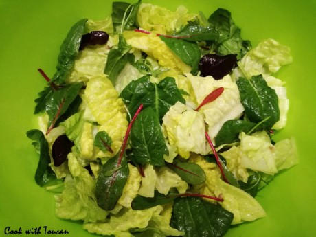 Salad mix with olive oil, lemon juice and chopped anchovy