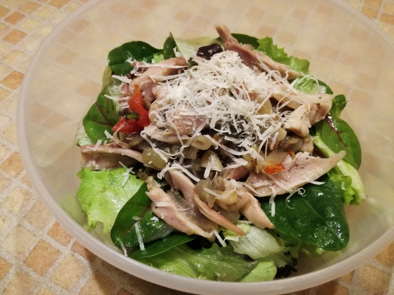 Shredded chicken with tomatoes, onion, fresh salad and Parmesan cheese