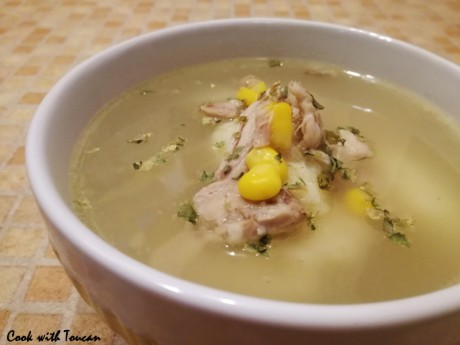 Chicken broth with corn and semolina dumplings