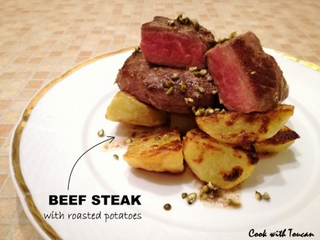 Beef steak with roasted potatoes and pickled green peppercorns
