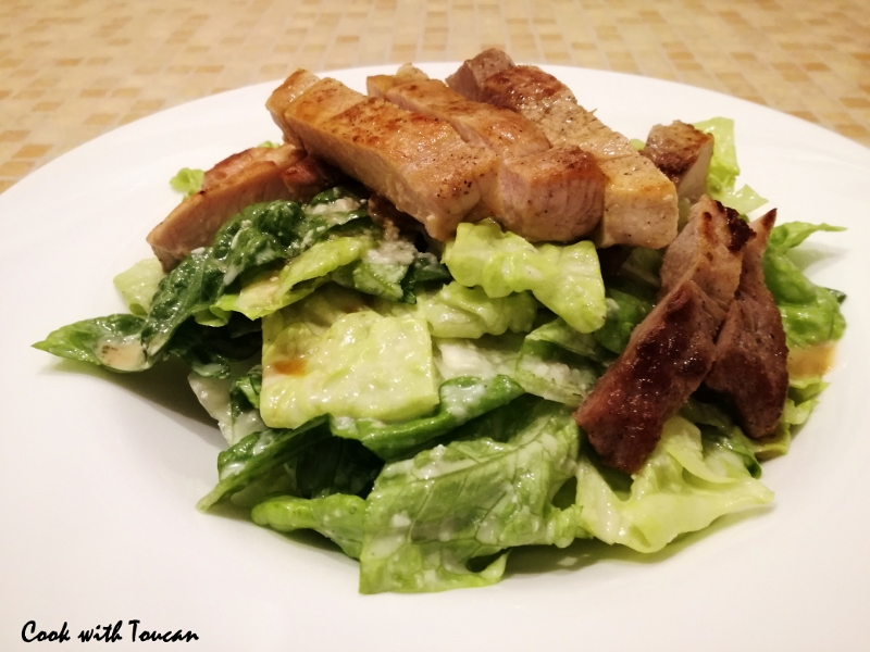 Pork steak and Roman salad with anchovy, Parmesan, olive oil and lemon juice